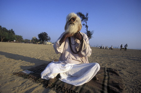 a Saddhu on the Chowpatty Beach in the city of Mumbai in India.