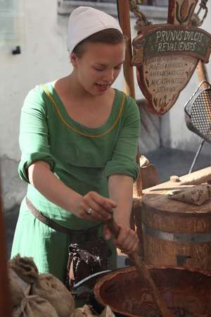 a women of a Shop in the old Town of Tallinn in Estonia in the Baltic countrys in Europe.