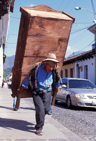 a men works in the old town in the city of Antigua in Guatemala in central America.