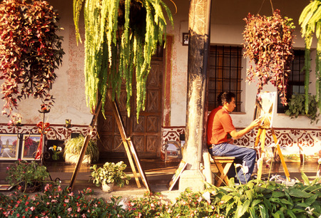 a painter in the old town in the city of Antigua in Guatemala in central America.