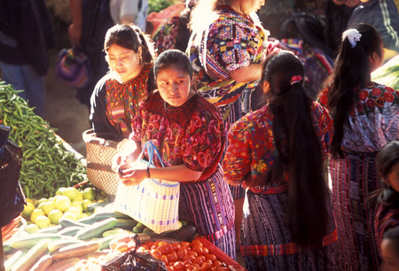 people in traditional clotes at the Market in the Village of  Chichi or Chichicastenango in Guatemala in central America.