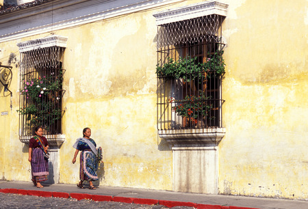 indio women in the old town in the city of Antigua in Guatemala in central America.