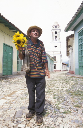 a  men in the old Town of the Village of trinidad on Cuba in the caribbean sea.