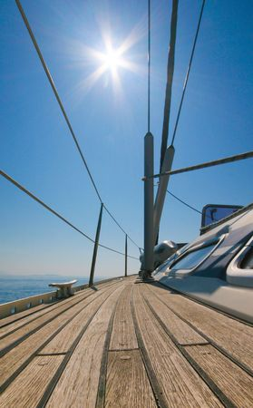 Sailboat deck with sun and blue sky