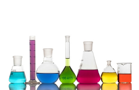 Photo for Laboratory glassware with colorful liquids on white background - Royalty Free Image