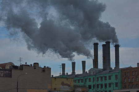 Photo for Smoking chimneys of a Moscow thermal power station in the city center. - Royalty Free Image