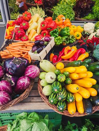 Foto de top down view on colorful vegetables on a market - Imagen libre de derechos