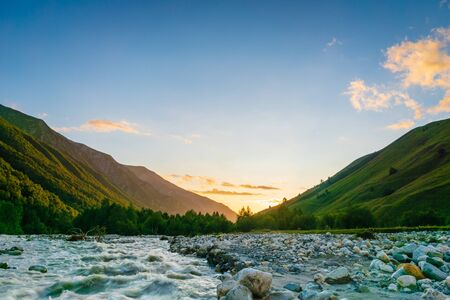 Foto de Svaneti landscape at sunset with mountains and river on the trekking and hiking route near Mestia village in Svaneti region, Georgia. - Imagen libre de derechos