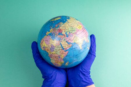 World Corona virus attack concept. world earth put mask to fight against Corona virus. Concept of fight against virus, danger and public health risk disease.