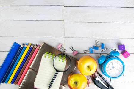 Photo for Various office stationery, notepad, clock, pencils, ooh, glasses, pen and two fresh apples on a white wooden table. Top view with copy space. Concept of office, education, workplace, school. - Royalty Free Image