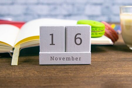November 16 on the wooden calendar.The sixteenth day of the autumn month, a calendar for the workplace. Autumn.