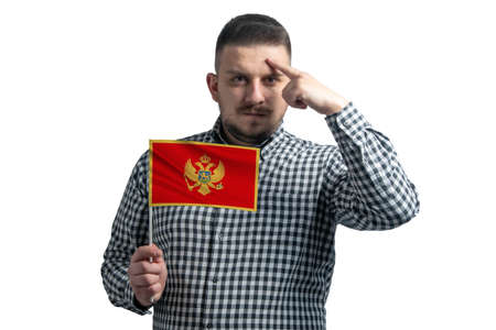 Photo pour White guy holding a flag of Montenegro and a finger touches the temple on the head isolated on a white background. - image libre de droit