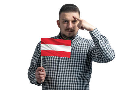 Photo pour White guy holding a flag of Austria and a finger touches the temple on the head isolated on a white background. - image libre de droit