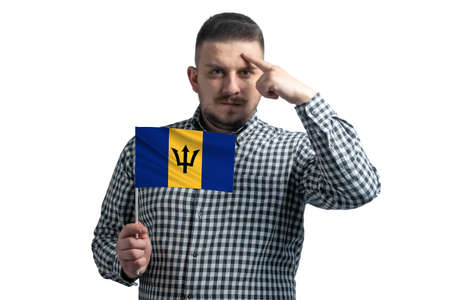Photo pour White guy holding a flag of Barbados and a finger touches the temple on the head isolated on a white background. - image libre de droit