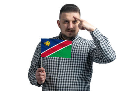Photo pour White guy holding a flag of Namibia and a finger touches the temple on the head isolated on a white background. - image libre de droit