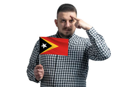 Photo pour White guy holding a flag of East Timor and a finger touches the temple on the head isolated on a white background. - image libre de droit