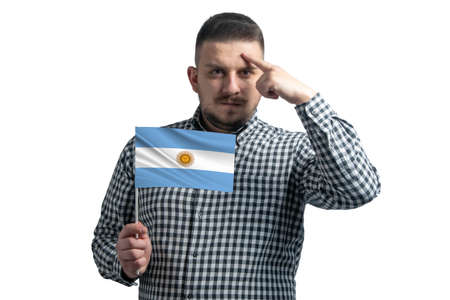 Photo pour White guy holding a flag of Argentina and a finger touches the temple on the head isolated on a white background. - image libre de droit