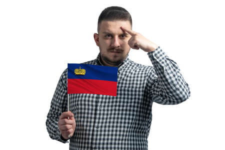 Photo pour White guy holding a flag of Liechtenstein and a finger touches the temple on the head isolated on a white background. - image libre de droit