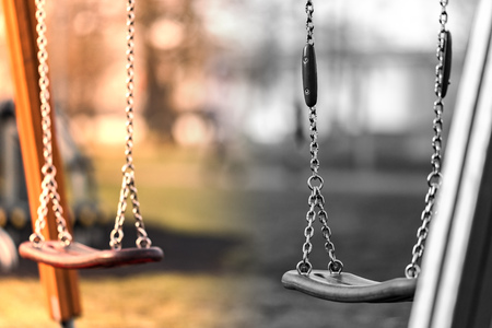 Photo pour Children's swing made of shiny iron chain. The background is blurred. Swing on the Playground. - image libre de droit