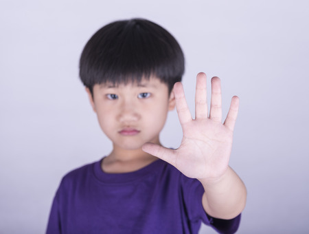 boy showing him denial with NO on him hand