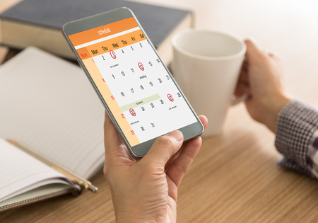 Photo pour The mark on your smart phone schedule on the calendar as reminders of important dates or to schedule a meeting or event. Remind Concept. - image libre de droit
