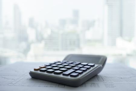 Foto de Calculator with business and financial report put on desk in office. - Imagen libre de derechos