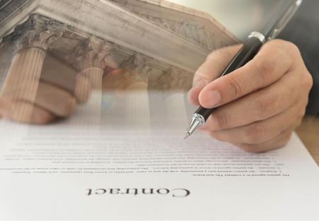 Business lawyer signing contract legal or attorney advisor at law firm.