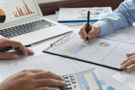 Foto de Financial advisor team are analyzing return on investment from business charts report. Concept of financial planning, accounting and data analysis. - Imagen libre de derechos