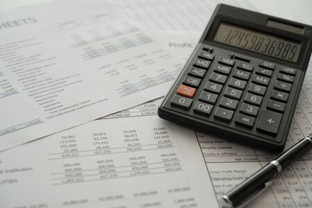 Foto de bookkeeping accounting concept. calculator on financial statement and balance sheet annual. - Imagen libre de derechos
