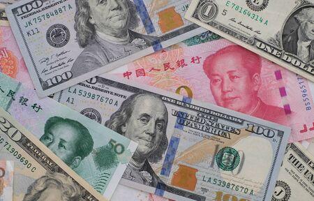 Photo pour Close up yuan banknotes and dollar banknotes. - image libre de droit