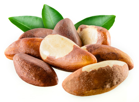 Brazil nuts with leafs isolated on white