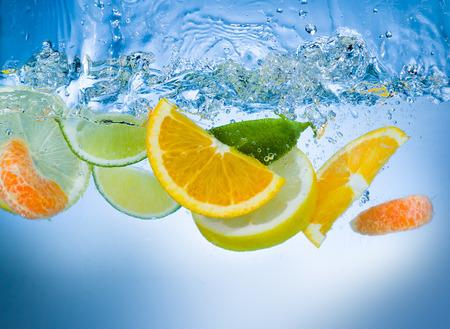 Fresh fruit slices under water