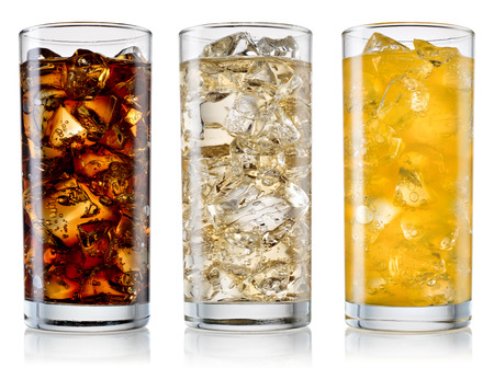 Foto de Glass of cola, fanta, sprite with ice cubes isolated on white. With clipping path - Imagen libre de derechos