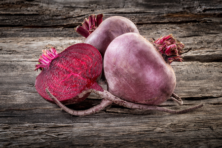 Fresh organic beetroot on wooden table, horizontalの写真素材