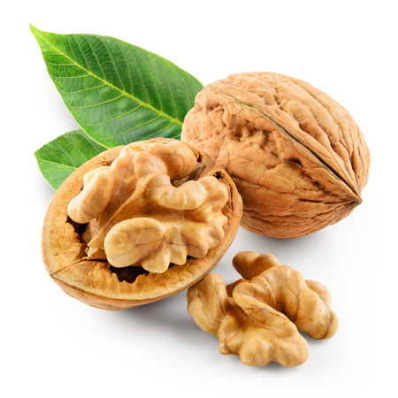 Walnuts with leaves in closeup. With clipping path.