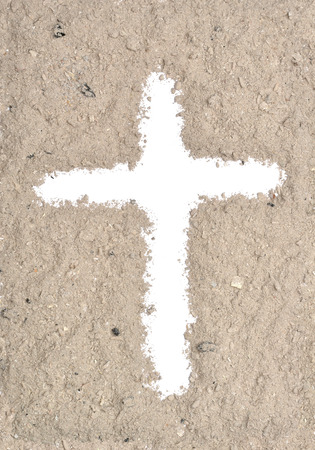White cross in ash