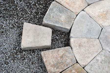 Photo for Installing decorative pavers in a circular pattern - Royalty Free Image