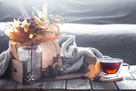 Foto per Autumn composition with elements of home decor with leaves in the interior of the living room, the concept of home comfort - Immagine Royalty Free