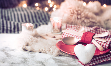 Photo pour Valentine's Day, festive dinner on a wooden background cutlery in a cozy homely atmosphere - image libre de droit