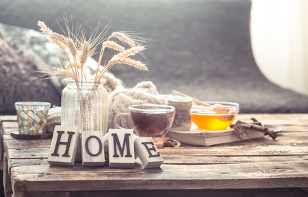 Photo for Still life details of home interior on a wooden table with letters home, the concept of coziness and home atmosphere .Living room - Royalty Free Image