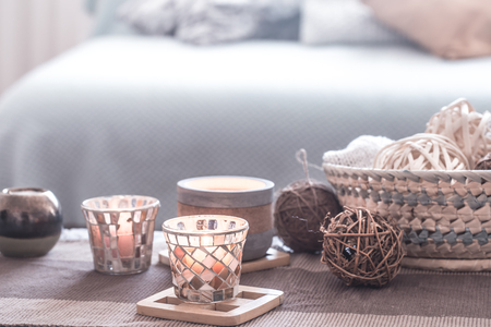Photo pour still life home cozy interior decor with candles on the background of the sofa with pillows, the concept of home comfort - image libre de droit