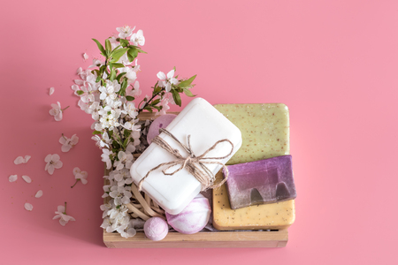 Foto de Spring Spa still life on an isolated pink background with spring flowers and organic body care products - Imagen libre de derechos