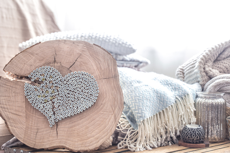 Photo pour decorative heart of nails on a wooden background in the interior of the room . The concept of home comfort and design - image libre de droit