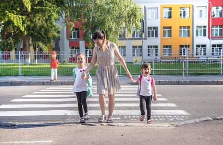 Photo for Back to school education concept with girl kids, elementary students, carrying backpacks going to class on school first day holding hand in hand together walking up building stair happily - Royalty Free Image