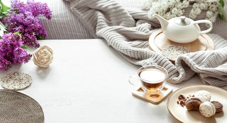 Photo for Cozy spring composition with tea and blooming lilac. Top view, flat lay - Royalty Free Image