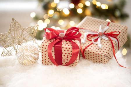 Foto de New year holiday background with a gift box in a cozy home atmosphere . The concept of the celebration. - Imagen libre de derechos