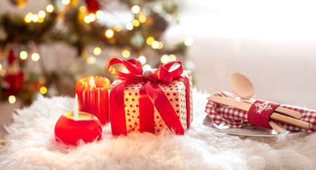 Foto de New year holiday background with a gift box in a cozy home atmosphere. The concept of the celebration. - Imagen libre de derechos