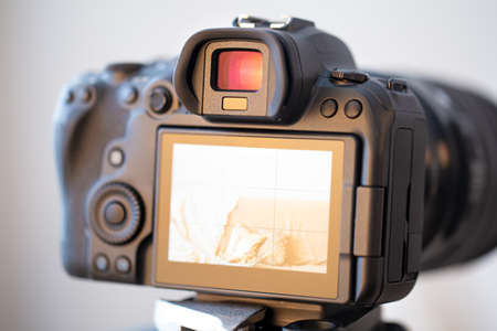 Photo for Close up of a professional digital camera on a blurred background. - Royalty Free Image