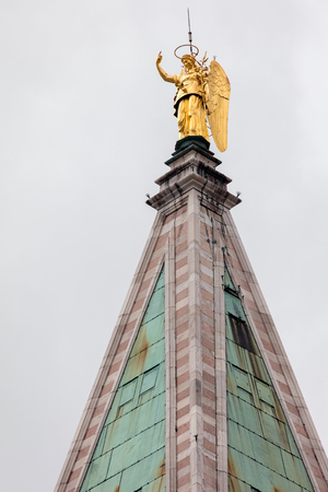 Golden angel Gabriel weather vane of top of the 16th century St. Mark's Campanile in Venice, Italy