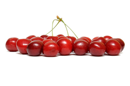 Freshly red cherry on a white background.